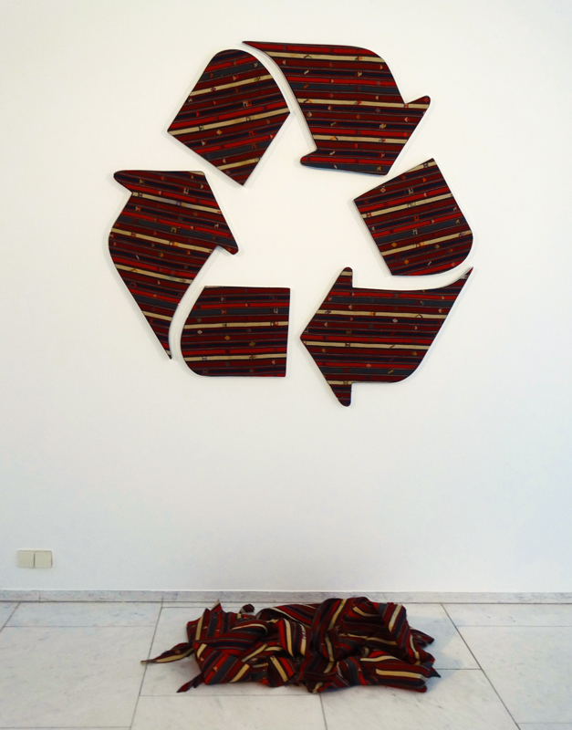 Faig Ahmed, Baku, Azerbaijan: Recycling signs made out of a cut-up old and valuable weaving; the rests are put on the floor