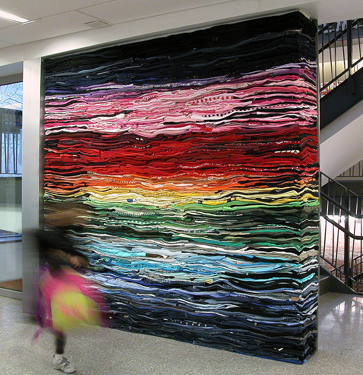 Derick Melander, Into the Fold 2, 2010, installation of folded and stacked second-hand clothing, 244 x 244 cm. Photo: Derick Melander