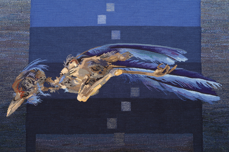 Barbara Heller, Canada: Tzimtzum - Transcendence - bird , detail; tapestry In Kabbalah, tzimtzum describes the first step whereby God began the process of creation, contracting his own essence to allow enough room for our material reality. By compressing his infinite self/light he allowed for a space in which a finite world seemingly independent of God could exist. And every day, by tikun we seek to repair the darkness in this world: our good deeds reunite our spirit with this infinite light through the transcendence of the material universe. The ladder has many interpretations. It can be seen as a metaphor for our life, as a link, a liminal space between birth and death, heaven and earth, tzimtzum and tikun, matter and spirit. As in the story of Jacob's ladder in the Torah, the bridge goes two ways and the squares can be seen as the angelic messengers in Jacob's dream. For me, the squares can also be seen as stepping stones on the path of spiritual attainment, of transcendence. Barbara Heller