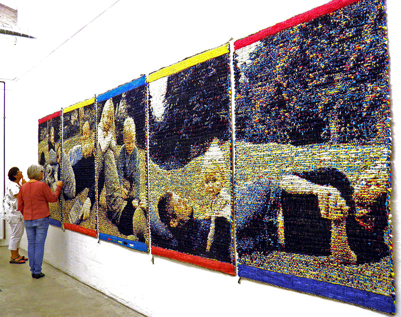 "Lise Frølund/DK: ""The Impossible Puzzle"" from 2012 consists of five oblong tapestries. Each oblong shows parts of grown ups and children in relaxed play. On the one side of each part of the tapestry the motifs are clearly recognizable, on the reverse side the colours are complementary. Apparently, the five oblongs hung in a sequence make up an integral whole, but whichever way you turn them, show them, front or back, fractured surfaces will appear when they are put together. Materials:Flax,polyester,paper.Measures: 6.4 by 1.4 metres"