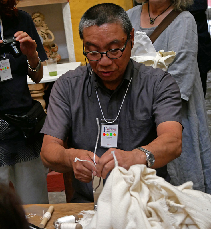 Hiroshi Murkse, from Arimatsu, Japan, demonstrating tie-dye techniques